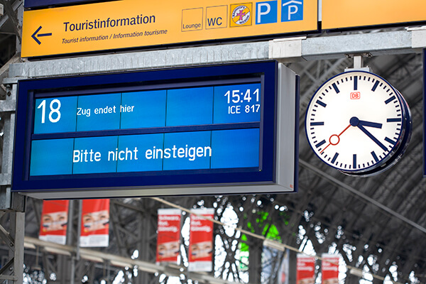 Digital signage in a train station. Germany: Information board on railroad station platform No. 18 at main station Frankfurt, Germany. German text means: Train ends here, do not enter!