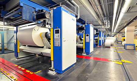 Machinery - paper rolls and offset printing machines in a large print shop for production of newspapers & magazines