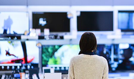 Consumer Electronics - Woman buys the TV