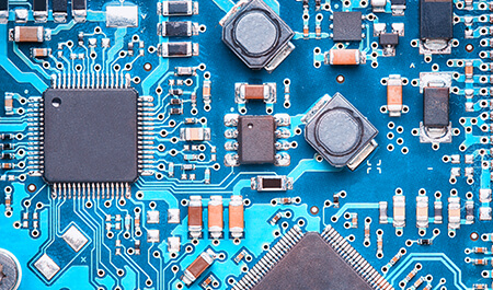 Embedded System - macro top view of a printed circuit board with processors, capacitors and transistors