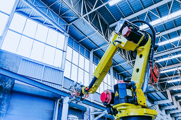 Large robot, technology and industry 4.0 revolution concept from high precision robotic system control set up at top of injection machine