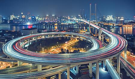 Public Transportation - Busy highway bridge at dusk, crosses river
